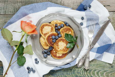 Breakfast of pancakes with ripe blueberry, top view