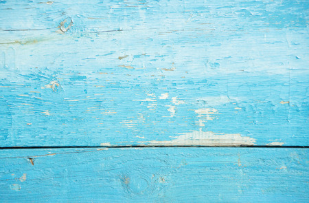 Natural old wooden background: blue tree cracking texture with paint flaking and uneven painted Imagens