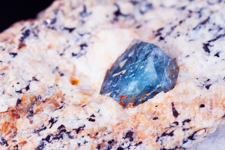 Collectible specimen of blue corundum Sapphire crystal in matrix close-up