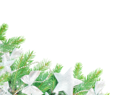 Christmas frame from green spruce branches decorated with silver Christmas baubles isolated on white background, with copy-space 写真素材
