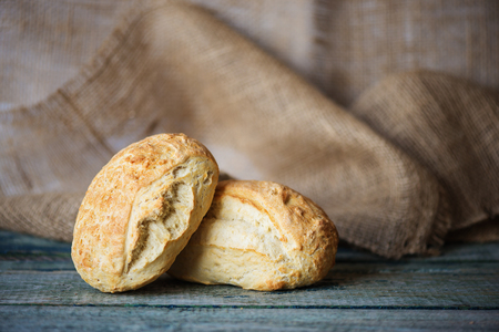Two fresh homemade bread ciabatta on the background of rough burlap, with copy-space. Ciabatta is tradition italian bakery product Stock Photo