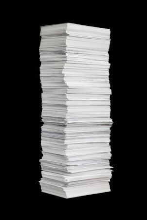 ?uge paper stack isolated on the black background