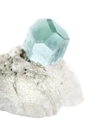 Blue mineral Beryl known as Aquamarine gemstone from Afghanistan, in an white albite matrix isolated on a white background