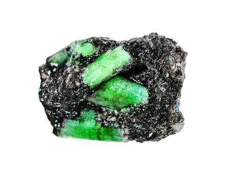 Several crystals of green mineral Beryl known as Emerald gemstone from Ural, in a micaceous slate matrix isolated on a white background
