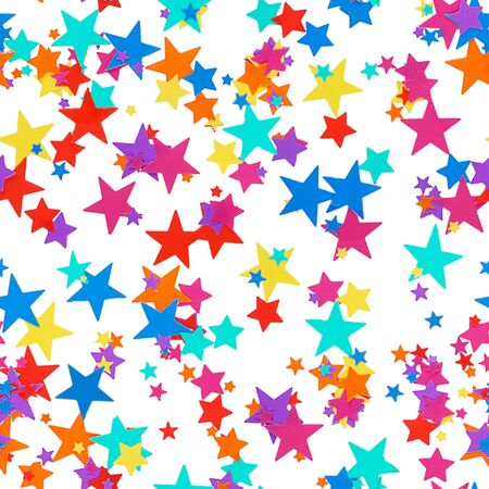 Multicolored festive background of colorful confetti in the shape of stars on a white background as a seamless pattern