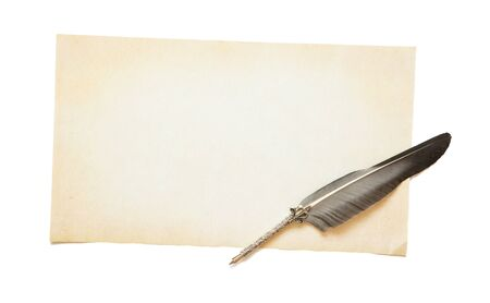 Empty yellowed sheet of old paper with copy-space and beautiful silver antique feather. Concept of literary creativity 版權商用圖片
