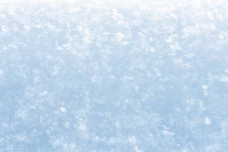 Beautiful snowy winter background with many snowflakes close-up Stock Photo
