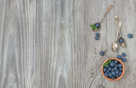 Still life in the old style with blueberry and wooden tableware Stok Fotoğraf