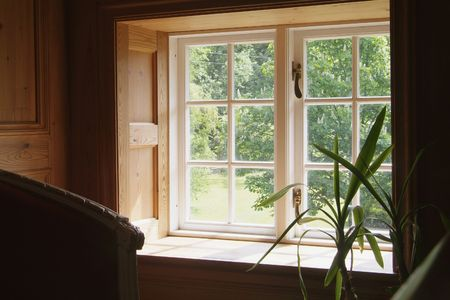 View through a window on the second floor of an old wooden house