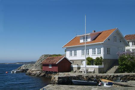 House and boathouse by the sea in Loshavn near Farsund in Vest-Agder on the south coast of Norway
