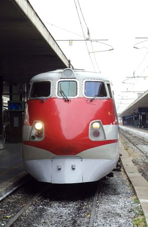 eurostar: Red, Italian express train holding at Termini, the main railway station in Rome, Italy. Stock Photo