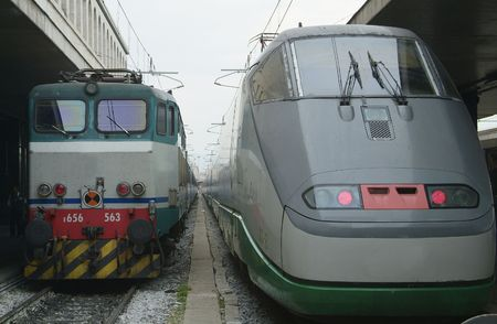 eurostar: A traditional electric locomotive and the high speed Eurostar side by side at Termini, the main railway station of Rome.