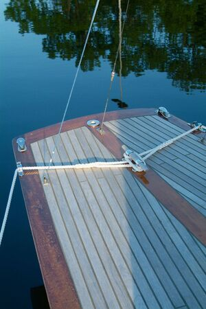 rear end: Rear end of classic, wooden sailboat with teak-deck Stock Photo