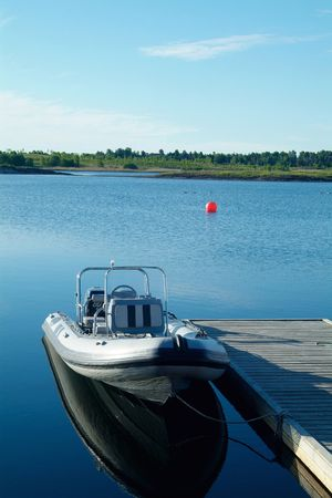 Rigid inflatable boat (RIB) at a floating pier Stock Photo