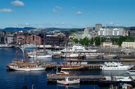 Boats at the quay in front of the City Hall of Oslo, Norway Stock Photo