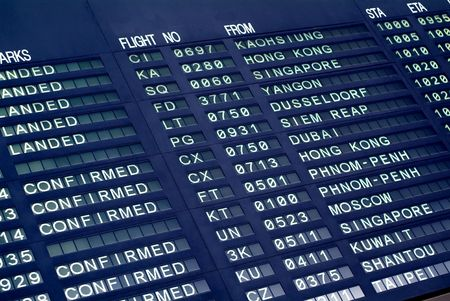 Electronic board with arrival times at an airport in Asia Stock Photo