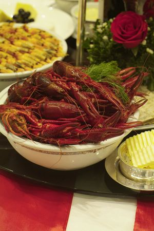 decapod: Crayfish and shrimps on a party-decorated table. Shallow depth of field.