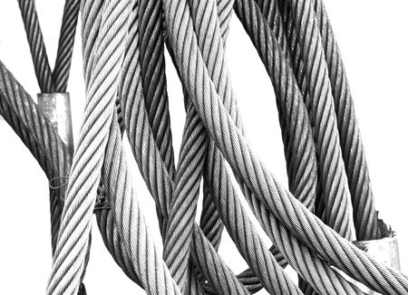 Hi-key, black and white photo of steel wires, isolated on white background.