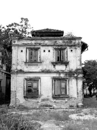 19th century: Old 19th century building, falling apart. Black and white photo.