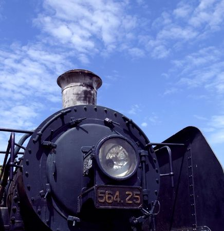 Front detail of old railway steam engine photo