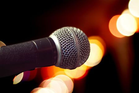 Close-up of microphone on blurred background. Very shallow depth of field, with parts of the microphone out of focus, Stock Photo
