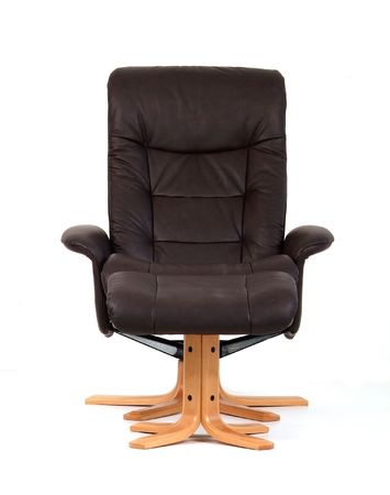 recliner: Black leather reclining chair with matching footstool. Front view, isolated on white. Stock Photo