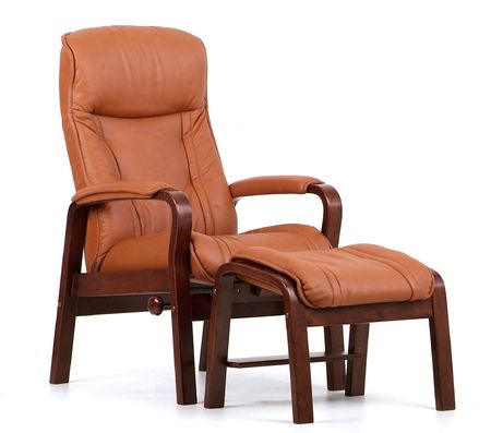 recliner: Brown wood and leather recliner with matching footstool. Isolated on white.