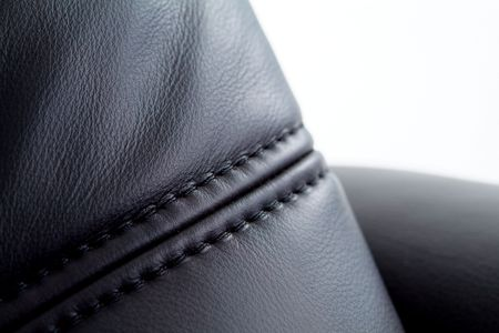 Seam on black leather furniture with white background. Shallow depth of field Stock fotó