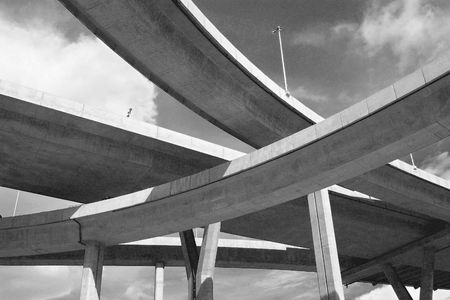 Motorway bridges crossing on different levels. Black and white photo. Stock Photo