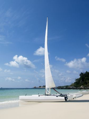 catamaran: Catamaran sailboat on a white, tropical beach on a sunny day at Koh Samet in Rayong province, Thailand