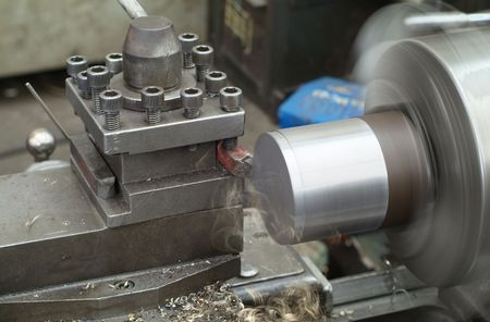 Lathe for metal materials. Motion blur and shallow depth of field.