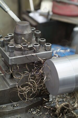 round rods: Lathe for metal materials. Motion blur and shallow depth of field.