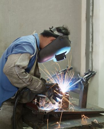 Welder working, welding steel tubes at a furniture factory Stock Photo - 1179233