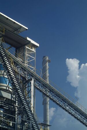 smoke stack: Detail of processing plant with conveyor belt and smoke stack
