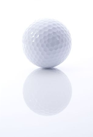 Golf ball with reflection on white and grey background