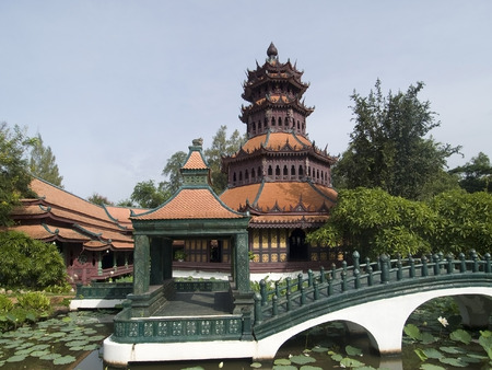 samut prakan: Traditional Asian architecture in a lush, tropical garden at Muang Boran, Samut Prakan, Thailand. Stock Photo