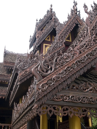 elaborate: Elaborate ornaments on a traditional building in Thailand.