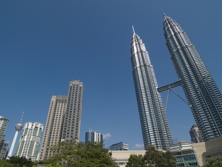 Kuala Lumpur skyline with considerable perspective distortion. Petronas Twin Towers to the right and Kuala Lumpur (KL) Tower at the lower left corner.