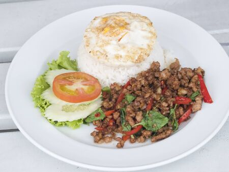 Thai food, kapao moo, minced pork fried with chilli pepper and sweet basil.  photo