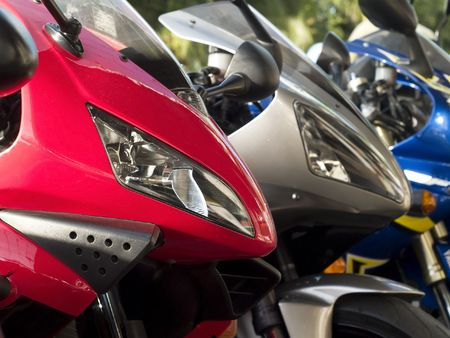 Details of three motorbikes. Shallow depth of field with the first bike in focus. photo