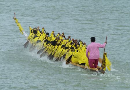 dragonboat: Paddlers in a longboat during a race in Thailand