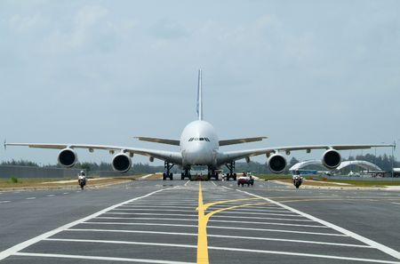 airliner: Very big airplane being towed at an airport