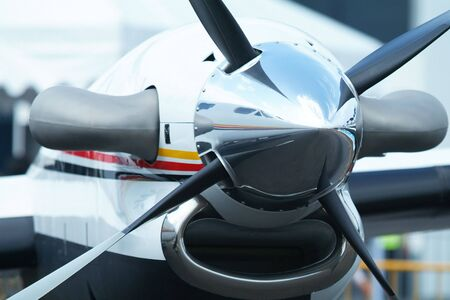 Propeller of twin engine, turboprop business aircraft with reflection of the aircraft in the propeller cone.