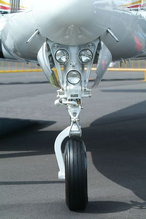 retractable: Retractable front landing gear of light, twin engine propeller aircraft. Stock Photo