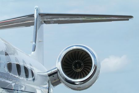 Rear detail with engine, tail-plane and windows of business-jet aircraft. Stock Photo