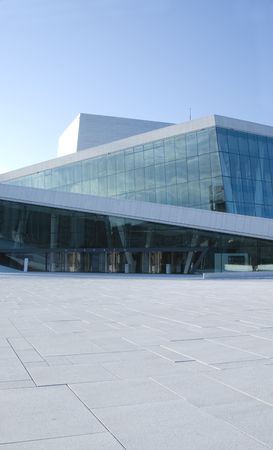 architectural firm: Detail of the new opera  in Oslo, Norway. The opera is designed by the Norwegian architectural firm Snohetta and opened in 2008. One of its architectural features, is that it is possible to walk on top of the whole building. The opera is situated in