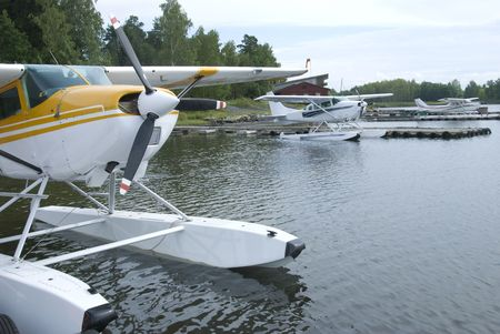 Three seaplanes moored at a harbour Stock Photo - 3814081