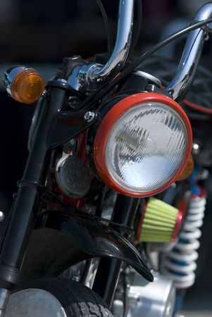 Front detail with headlight of small, light motorbike. photo