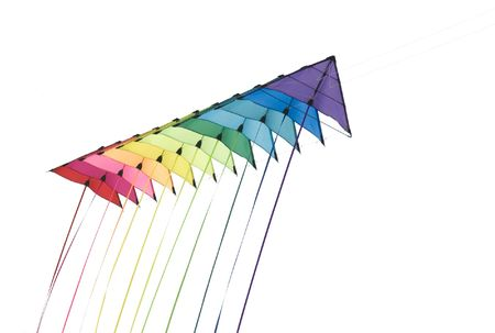 A string of colourful stunt kites isolated on white background.