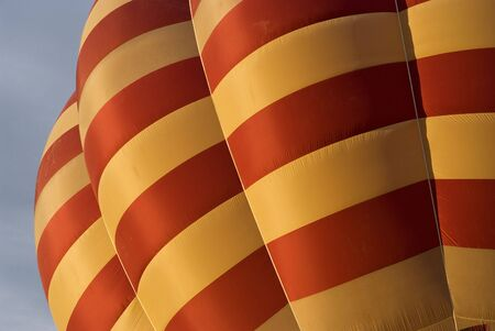 Detail of striped hot air balloon on a cloudy background photo